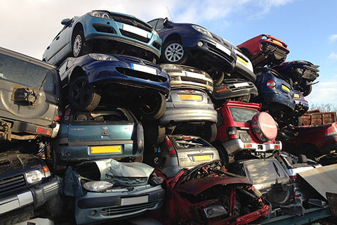 A stack of scrap cars at DST Ltd